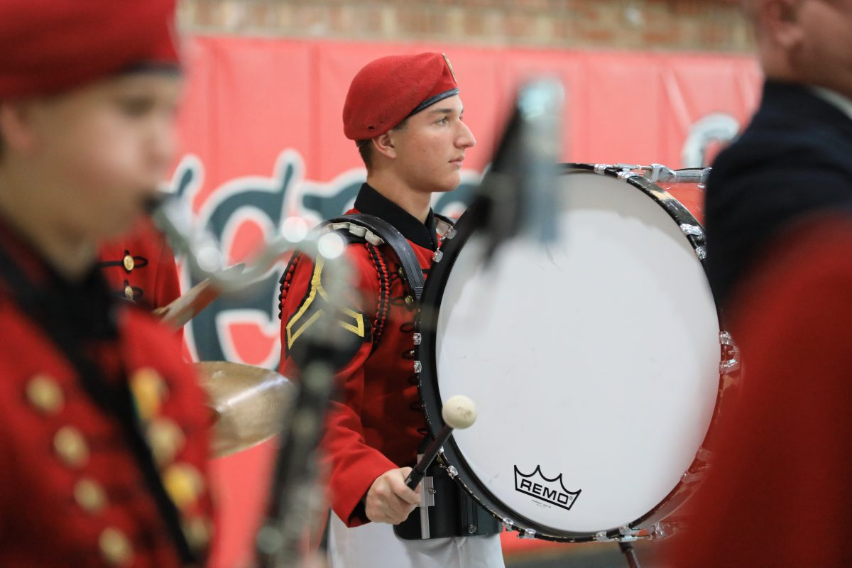 St. John's Northwestern Academies Marching band Student playing a drum