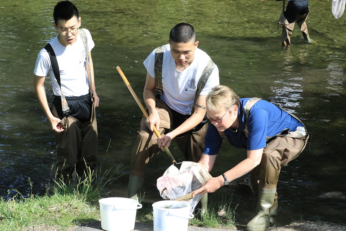 Students cleaning river
