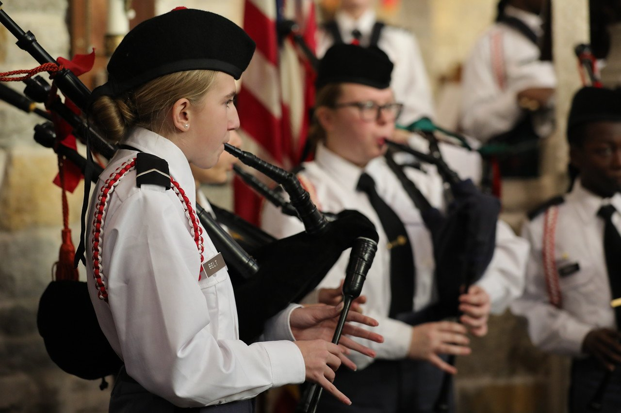 St. John's Northwestern Students playing bagpipes