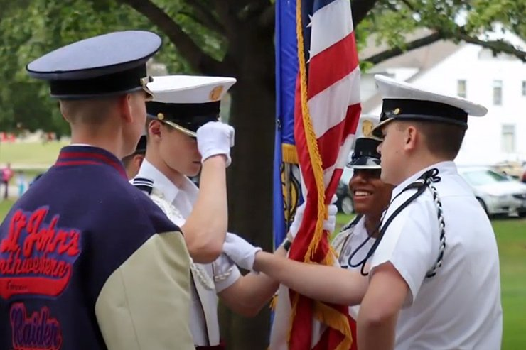 Young cadets holding American flag